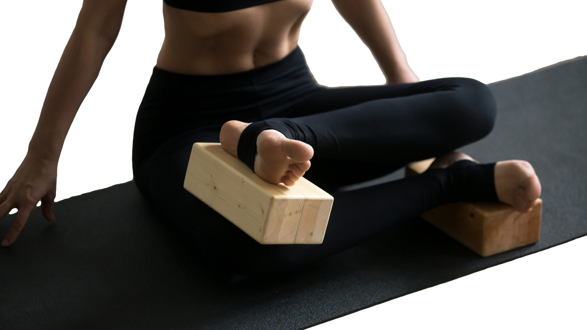 Close up of seated yoga pose using blocks for tight hips.