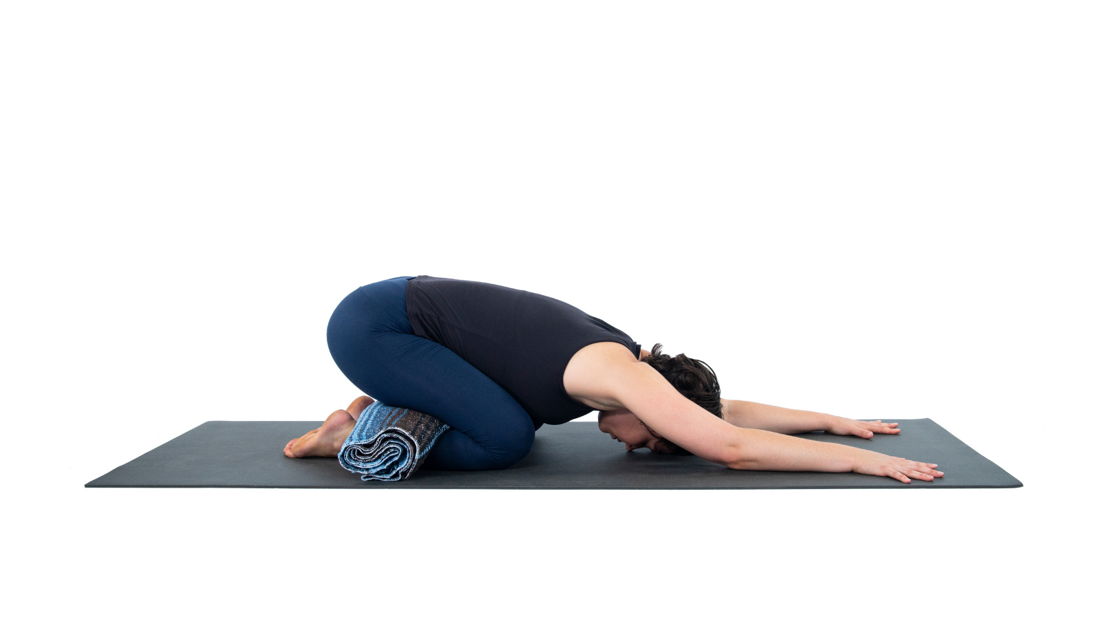 Practicing a variation of Child's Pose or Balasana to make it comfortably your own version