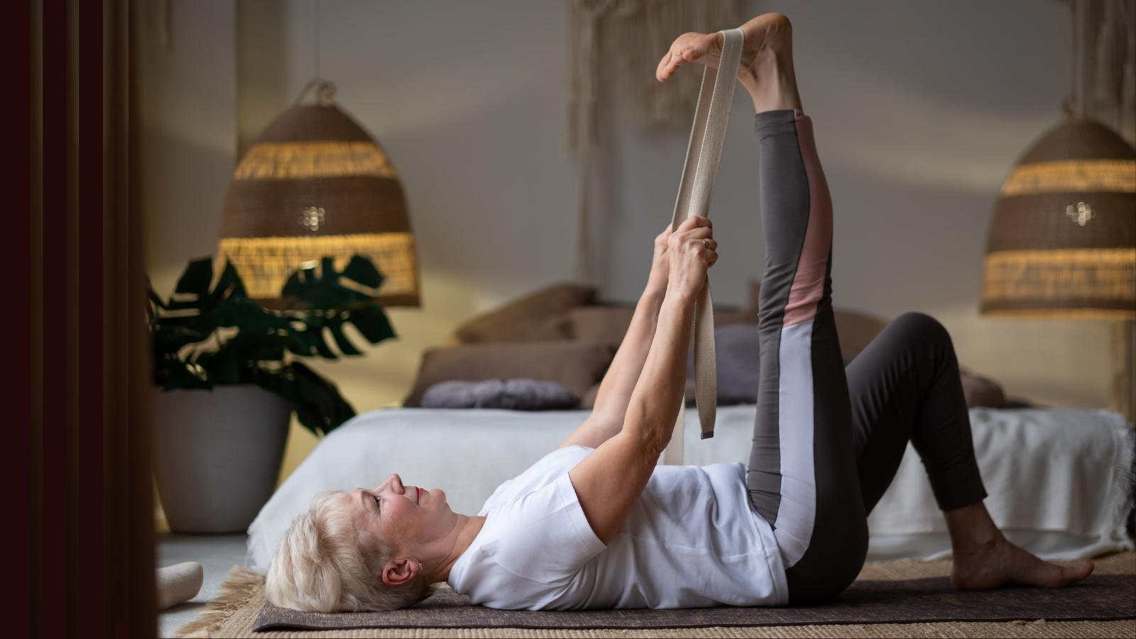 Yoga student practicing Reclined Hand to Big Toe pose with reference to flexion and extension