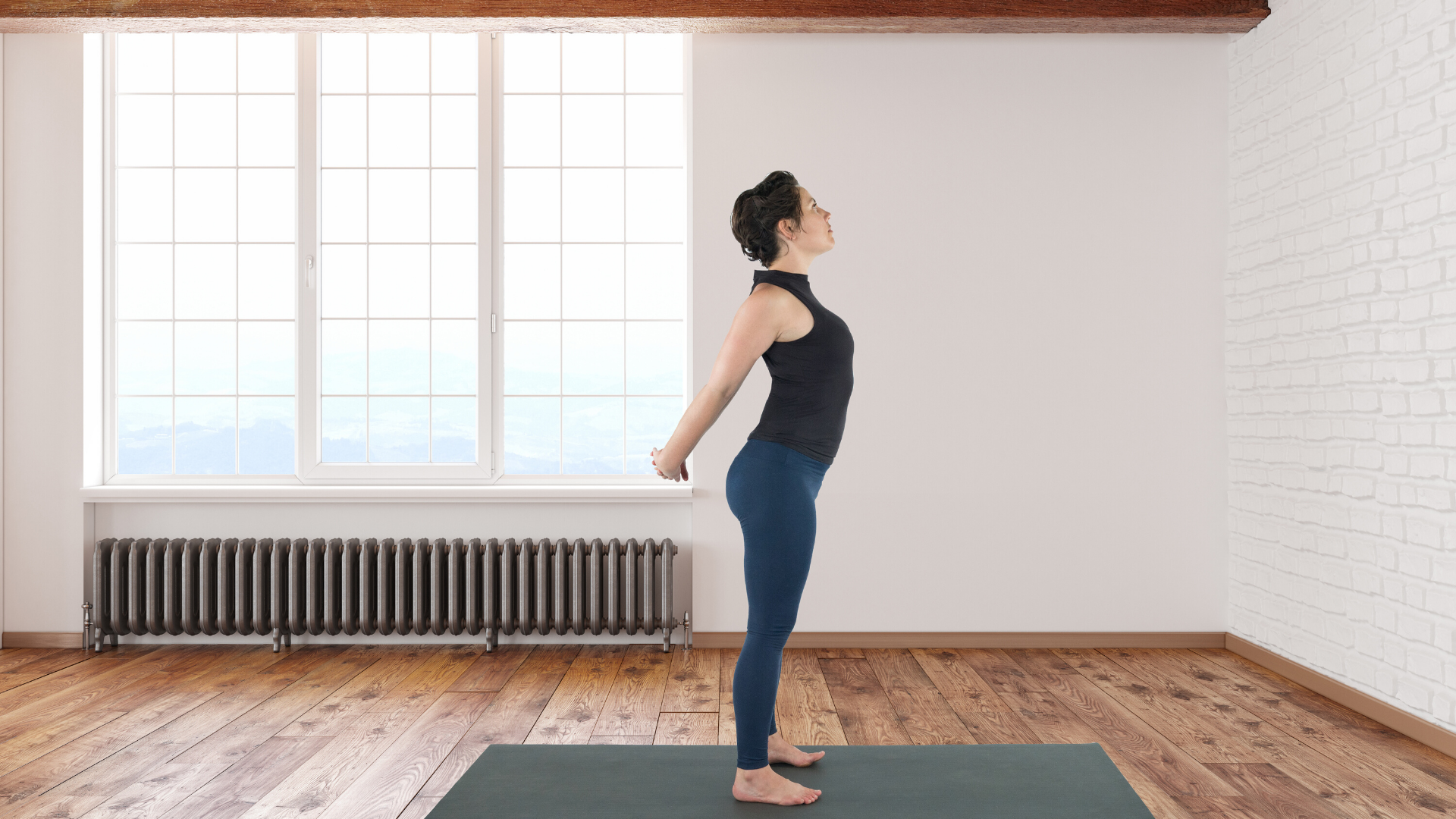 Woman practicing yoga chest opening stretch.