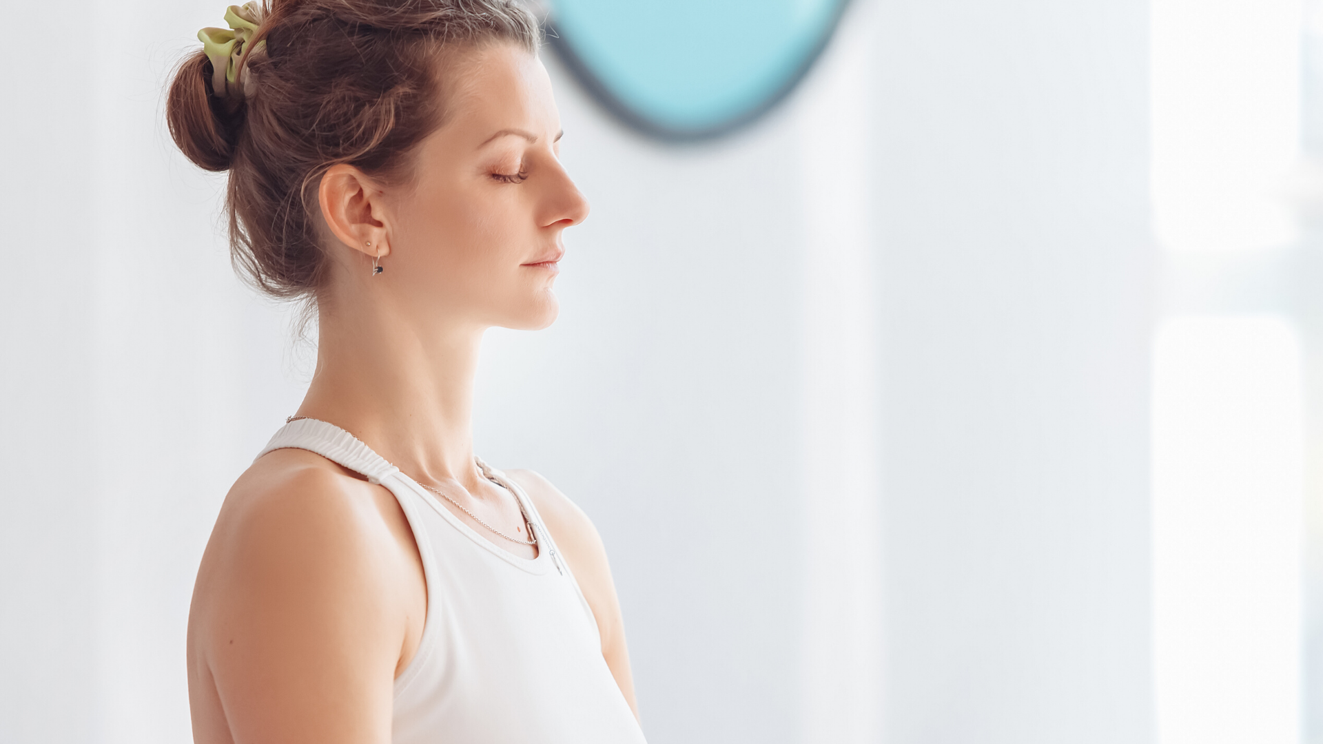 Woman practicing yoga meditation with eyes closed.