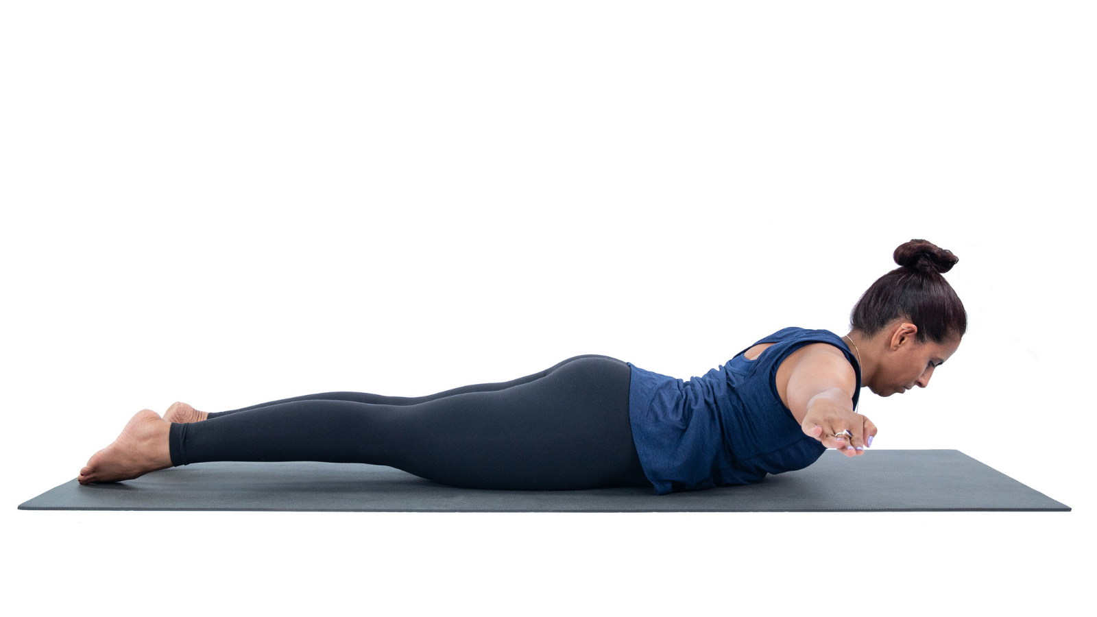 Practicing Cobra Pose or Bhujangasana as part of the yoga practice to open the heart chakra