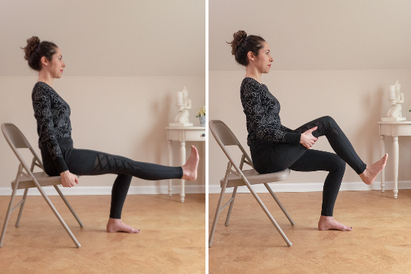Woman seated in a chair extending one leg in front and then holding thigh to roll her ankle yoga