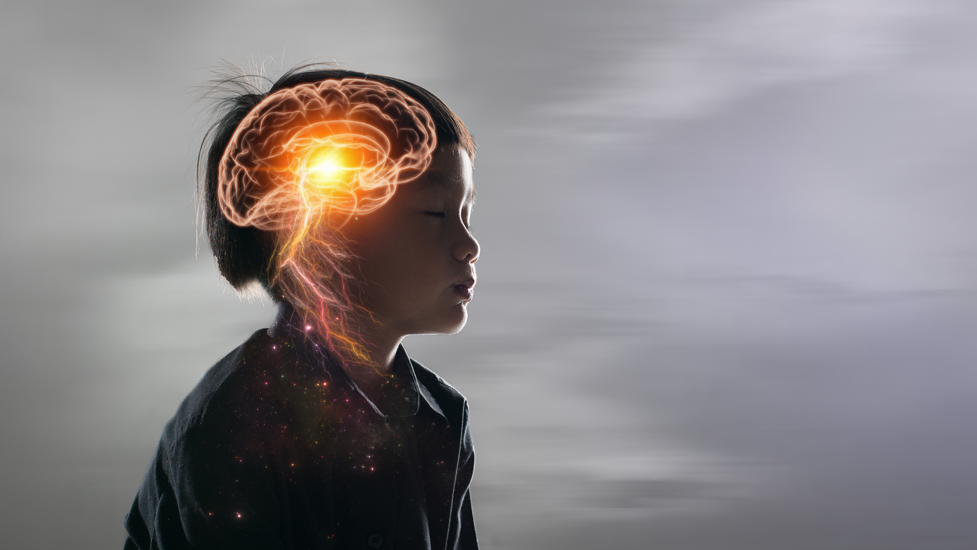 Small child seated with eyes closed - his brain and nervous system are glowing.