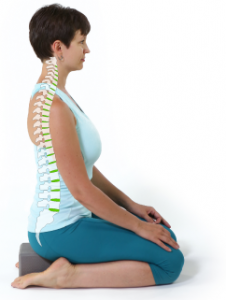 Woman in Seated yoga Pose (vajrasana) demonstrating good posture