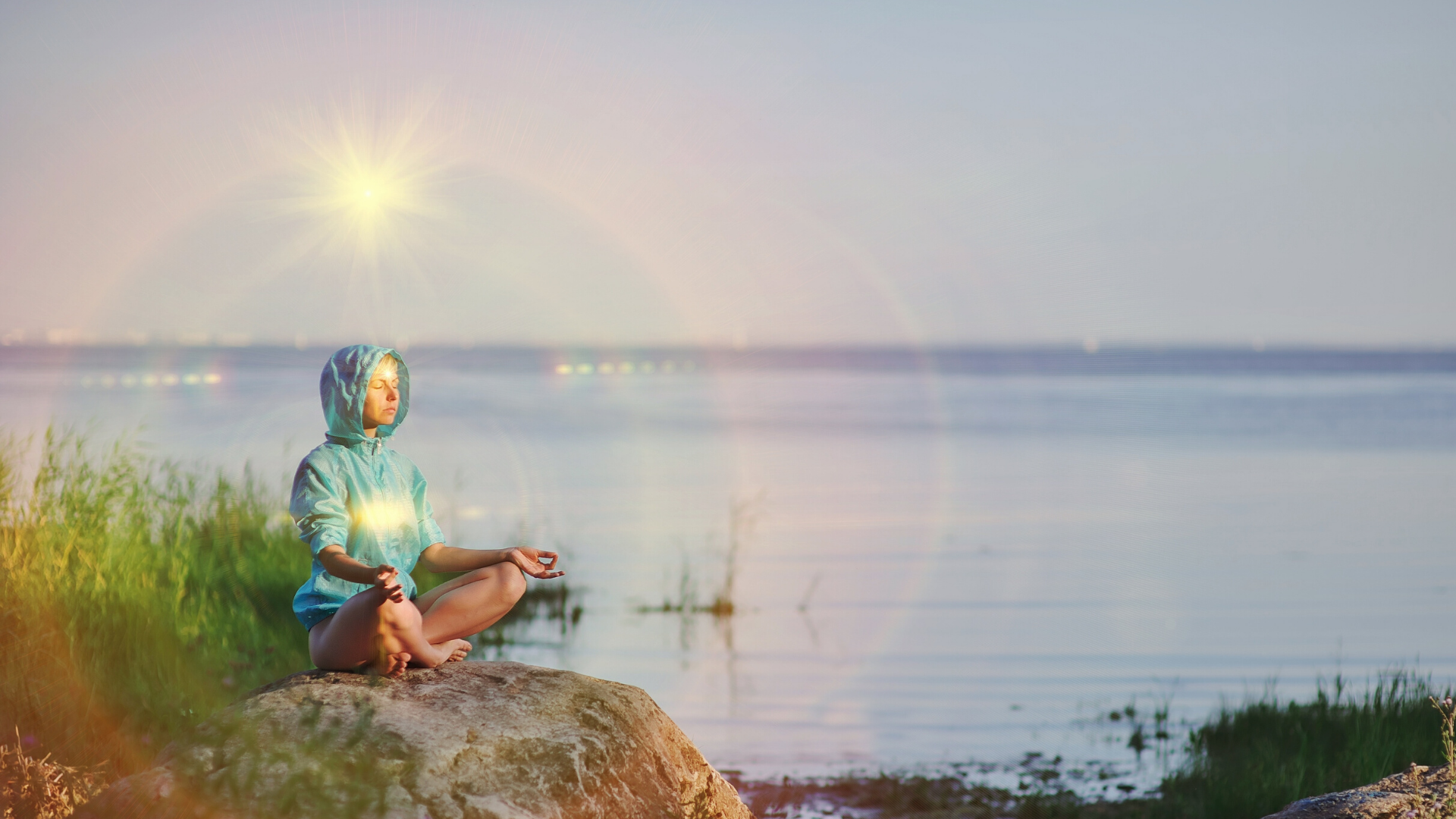 Woman seated in meditation practicing yoga with heart and crown chakra illuminated.