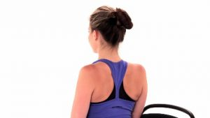 woman practicing scapular retraction to relieve neck pain