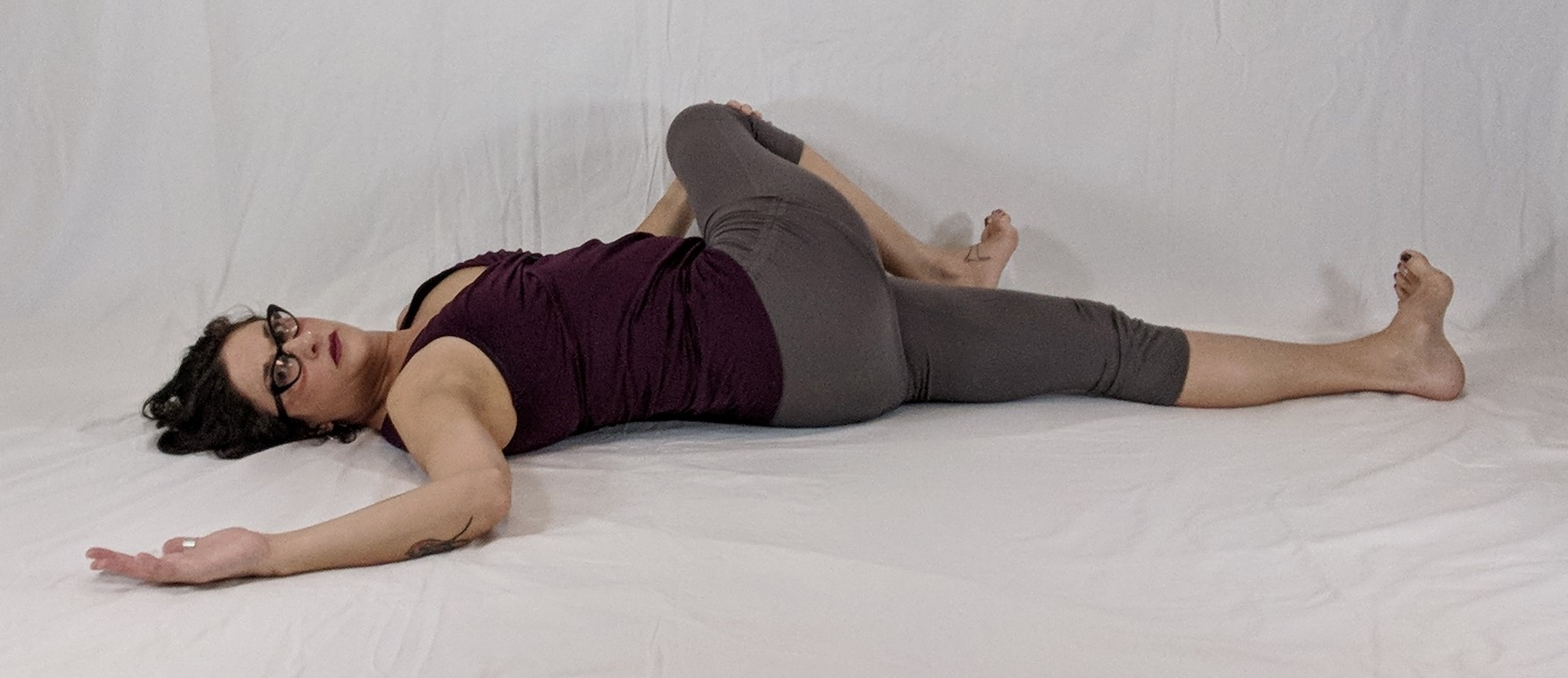 floor flow twist, supine yoga asana, gentle flow, spinal flexibilty, yoga warm up, yoga for cancer, yoga  for lymphedema