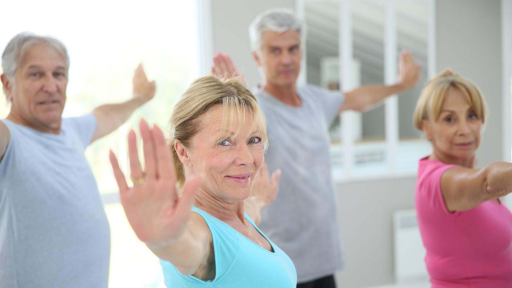 Yoga class with seniors, Yoga for spinal health, Yoga over 50