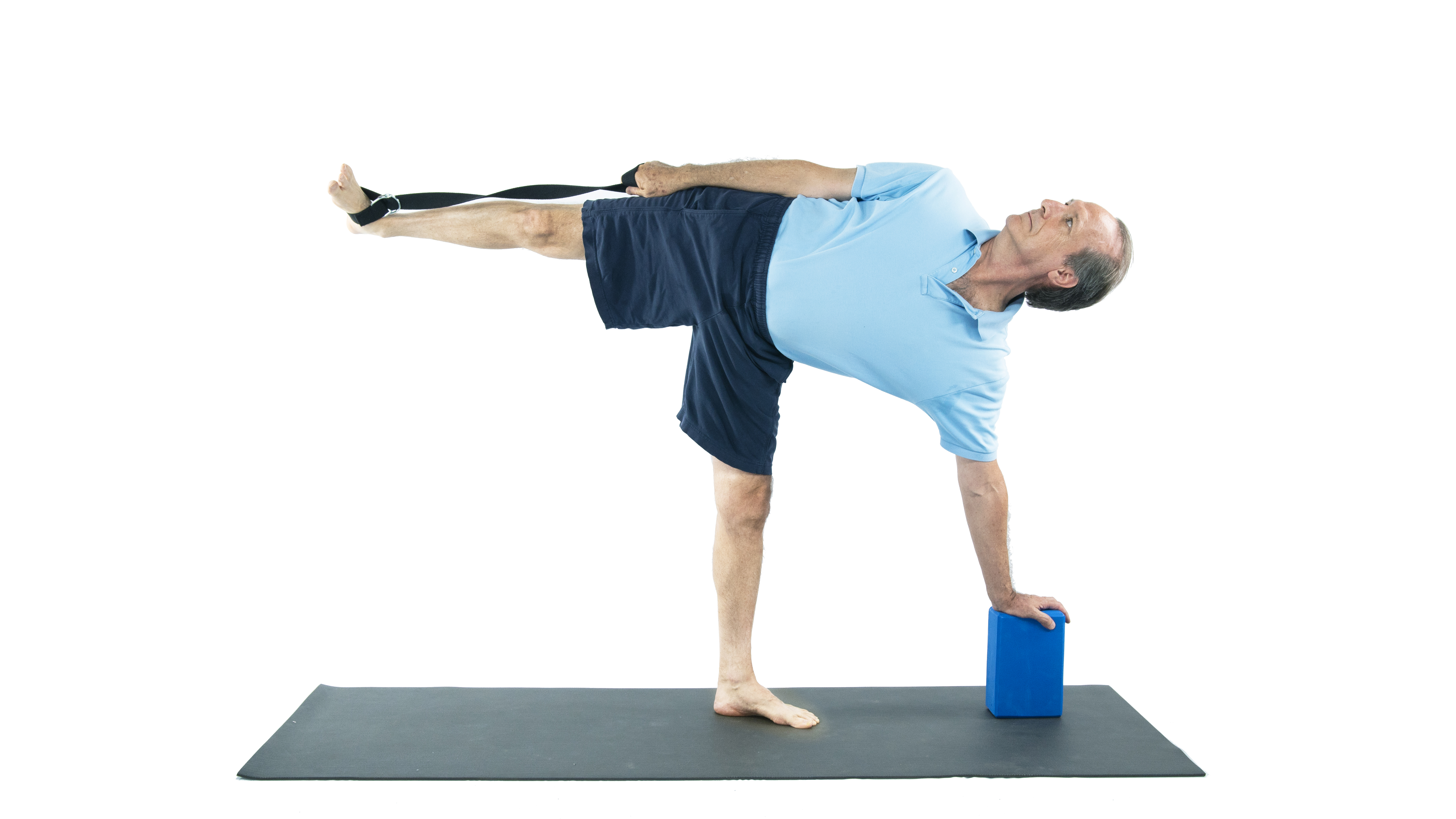 man practicing half moon with yoga props