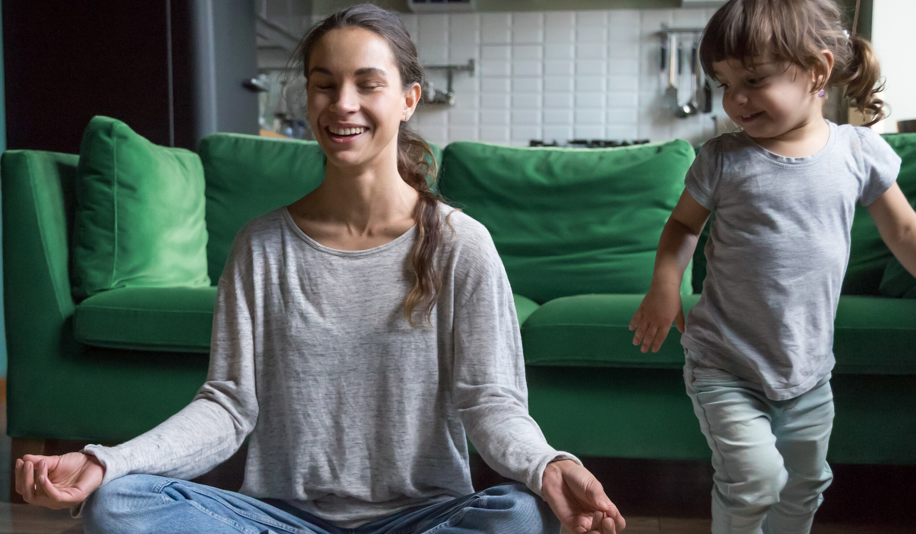 mother practicing meditation with toddler