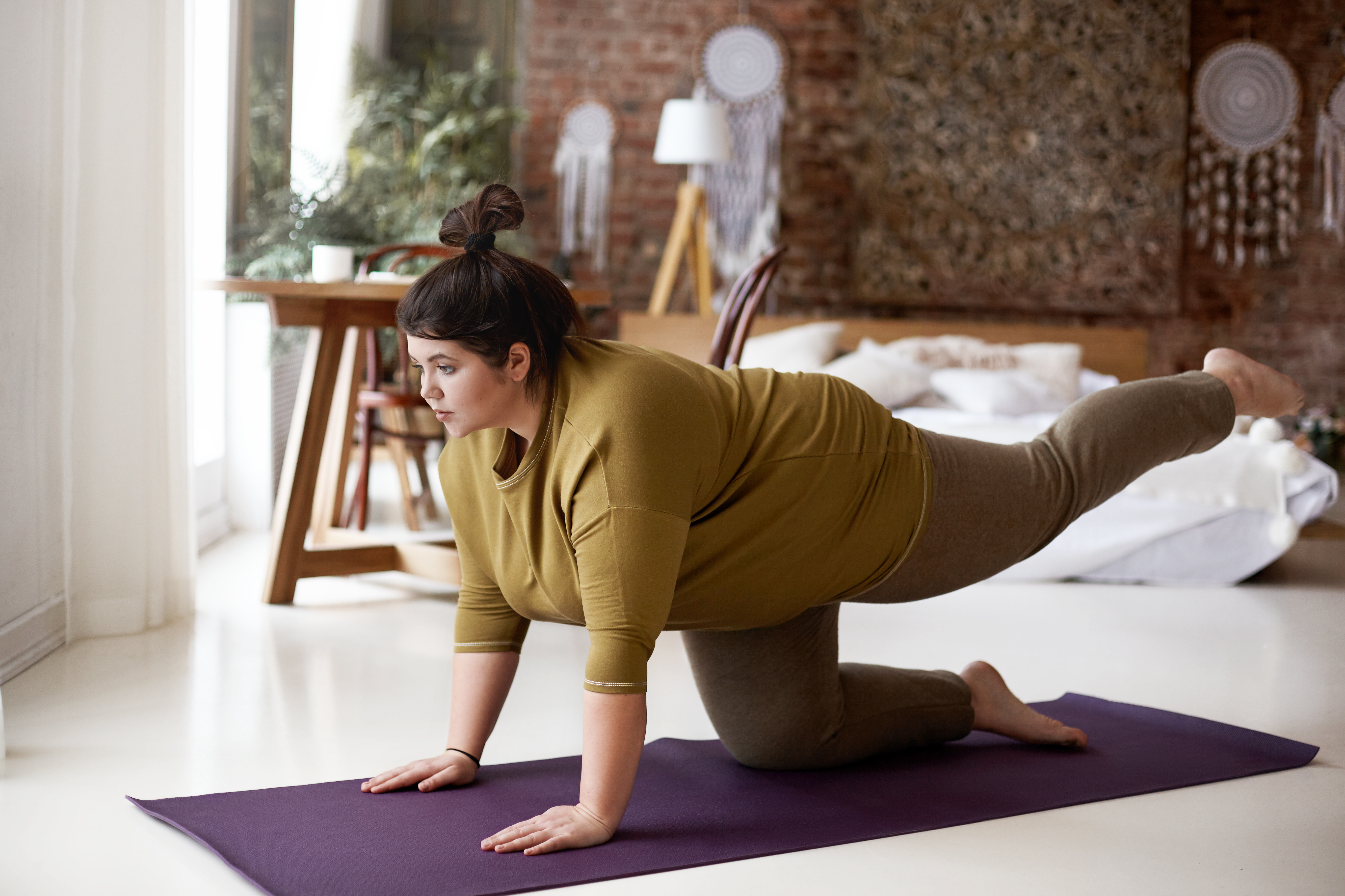 Larger woman practicing yoga, weight issues and yoga, diverse yoga classes