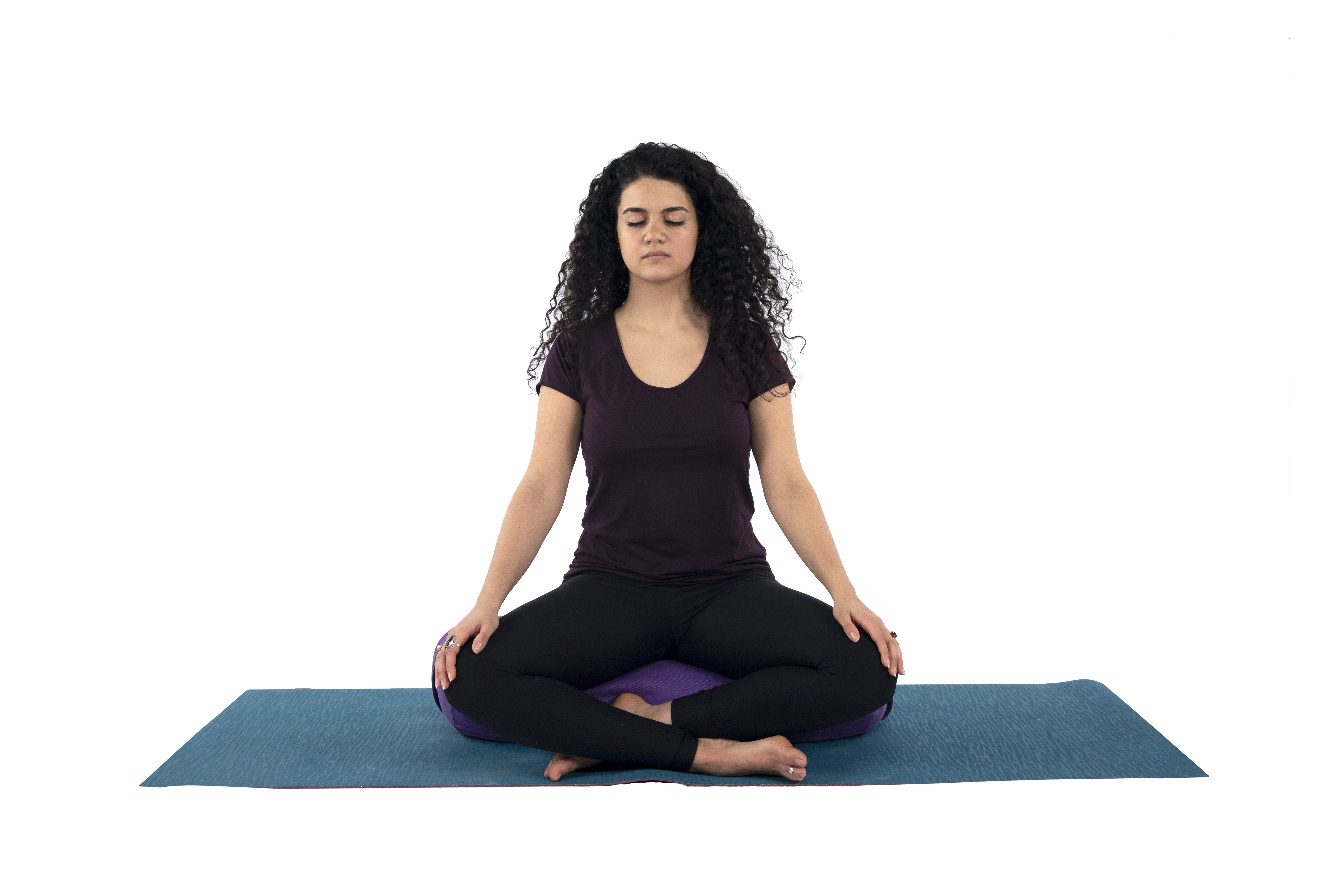 woman in meditation yoga pose for runners