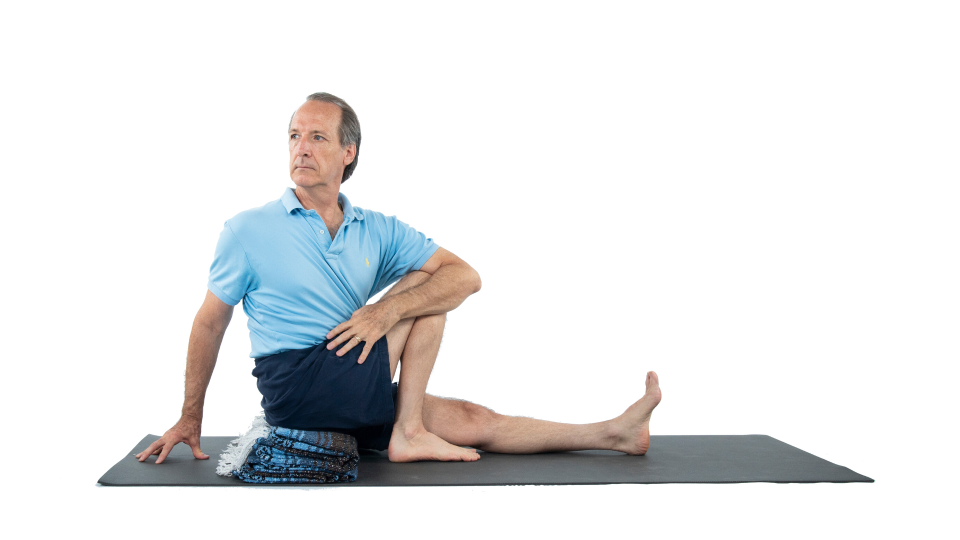 Man practicing yoga Sage's Pose (marichyasana)