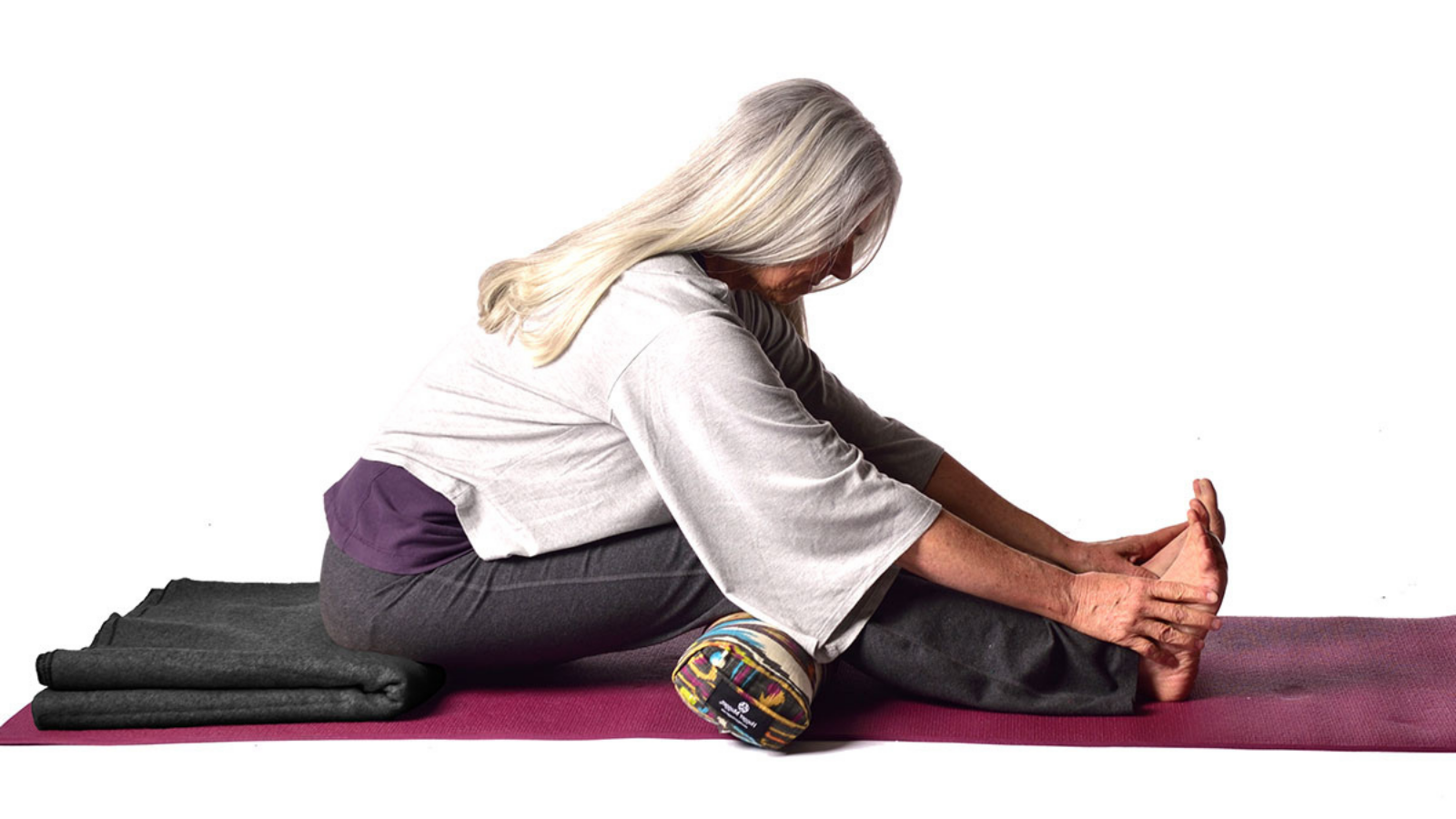 How to maintain spinal integrity in forward folds in Seated Forward Bend Pose (Paschimottanasana) with props