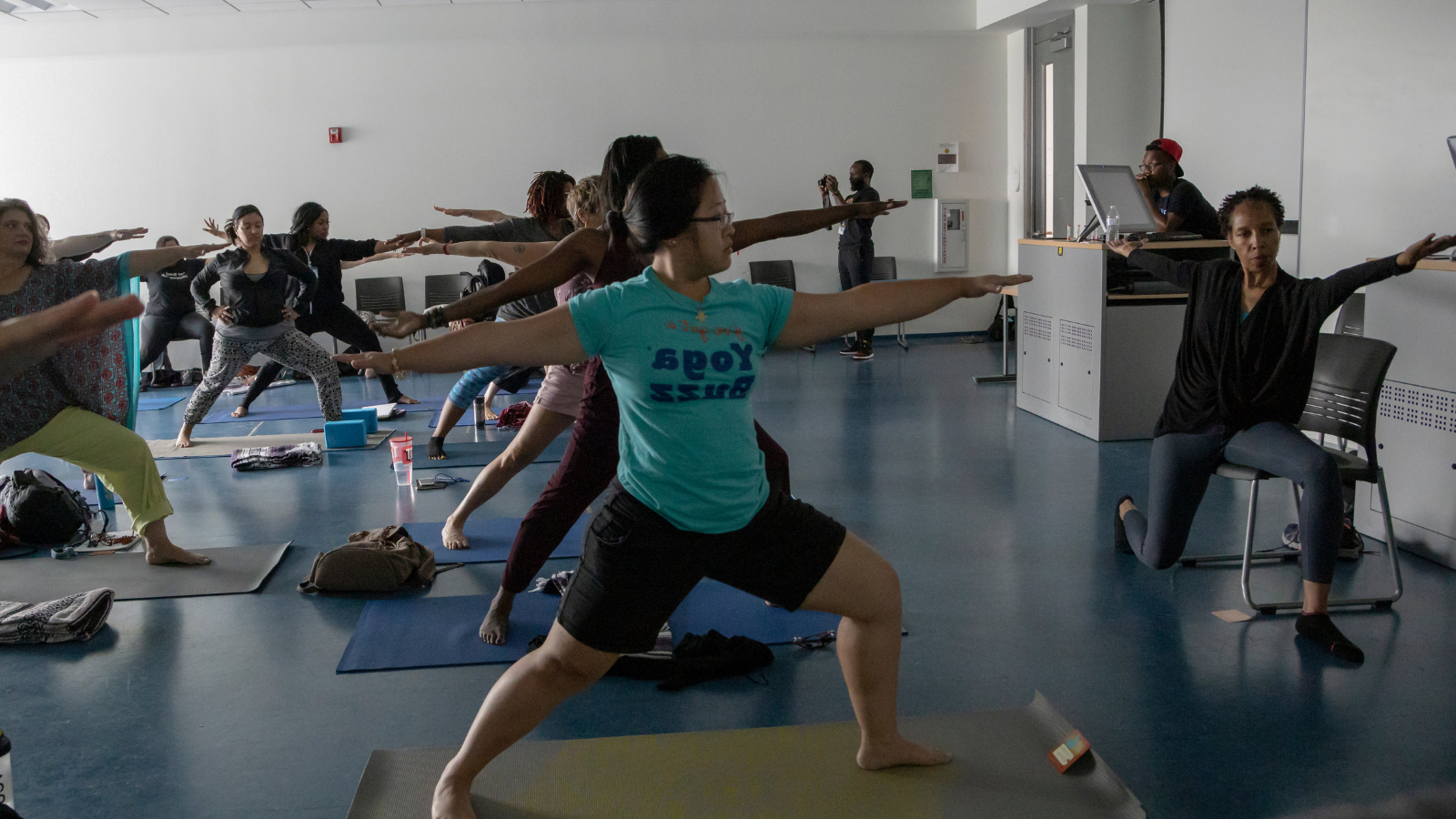 Providing yoga pose variations. chair yoga, providing props and chairs in yoga class, accessibility for all yoga students