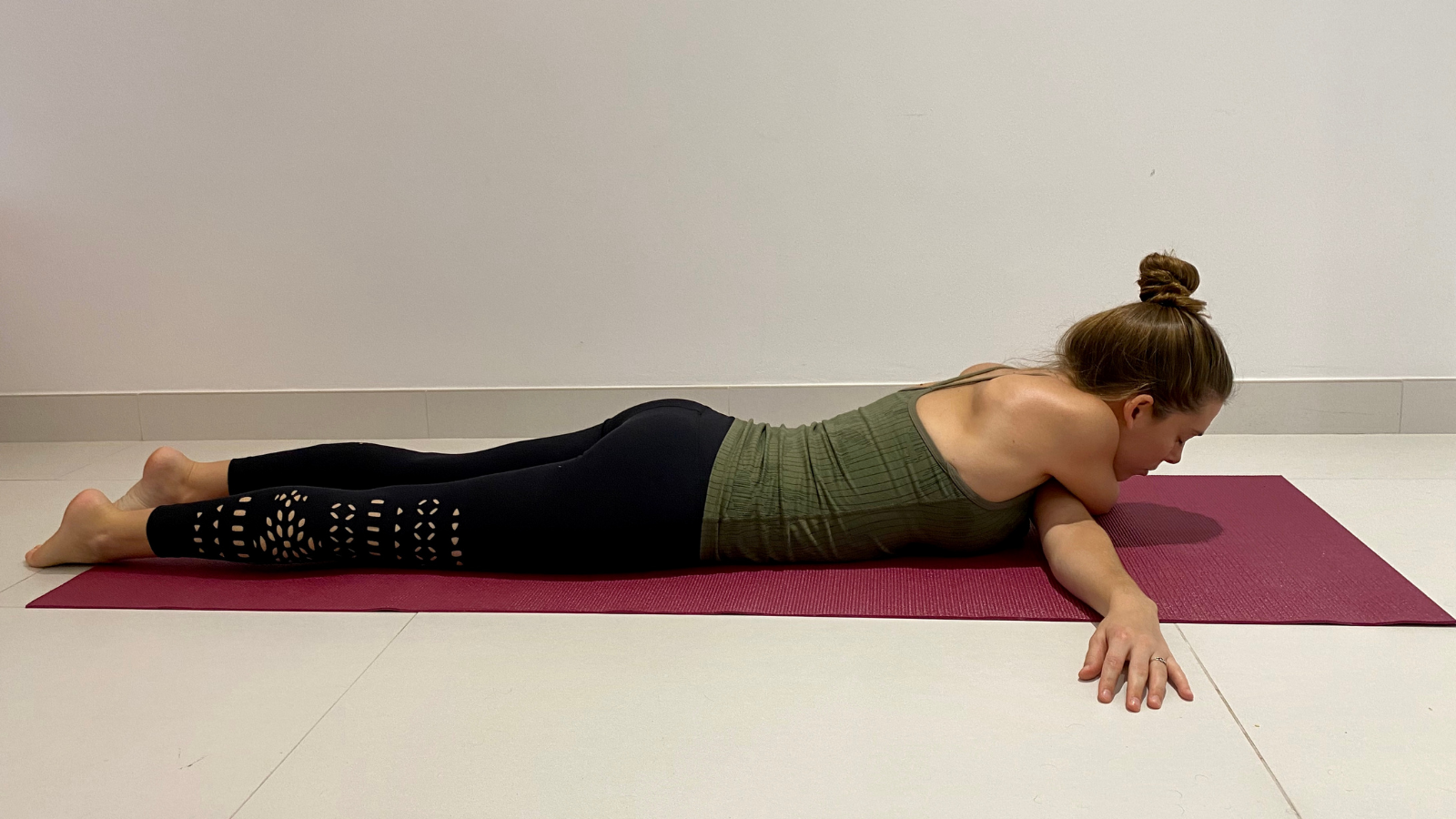 The benefits of practicing Bow Tie yoga Pose to help alleviate the symptoms of back pain