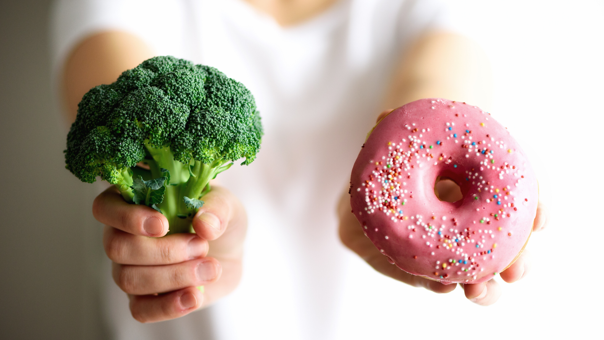 Image of a donut and a head of broccoli.