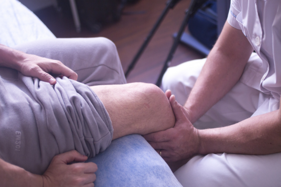 Doctor checking out a patient's knee