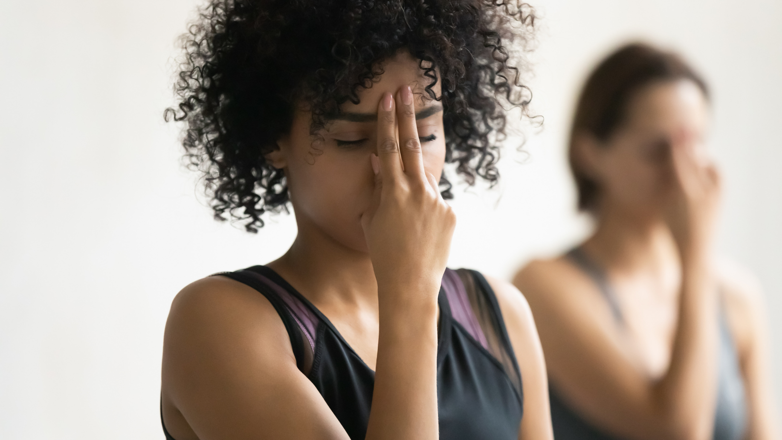 Women practicing Alternate Nostril powerful breathing practices in yoga class