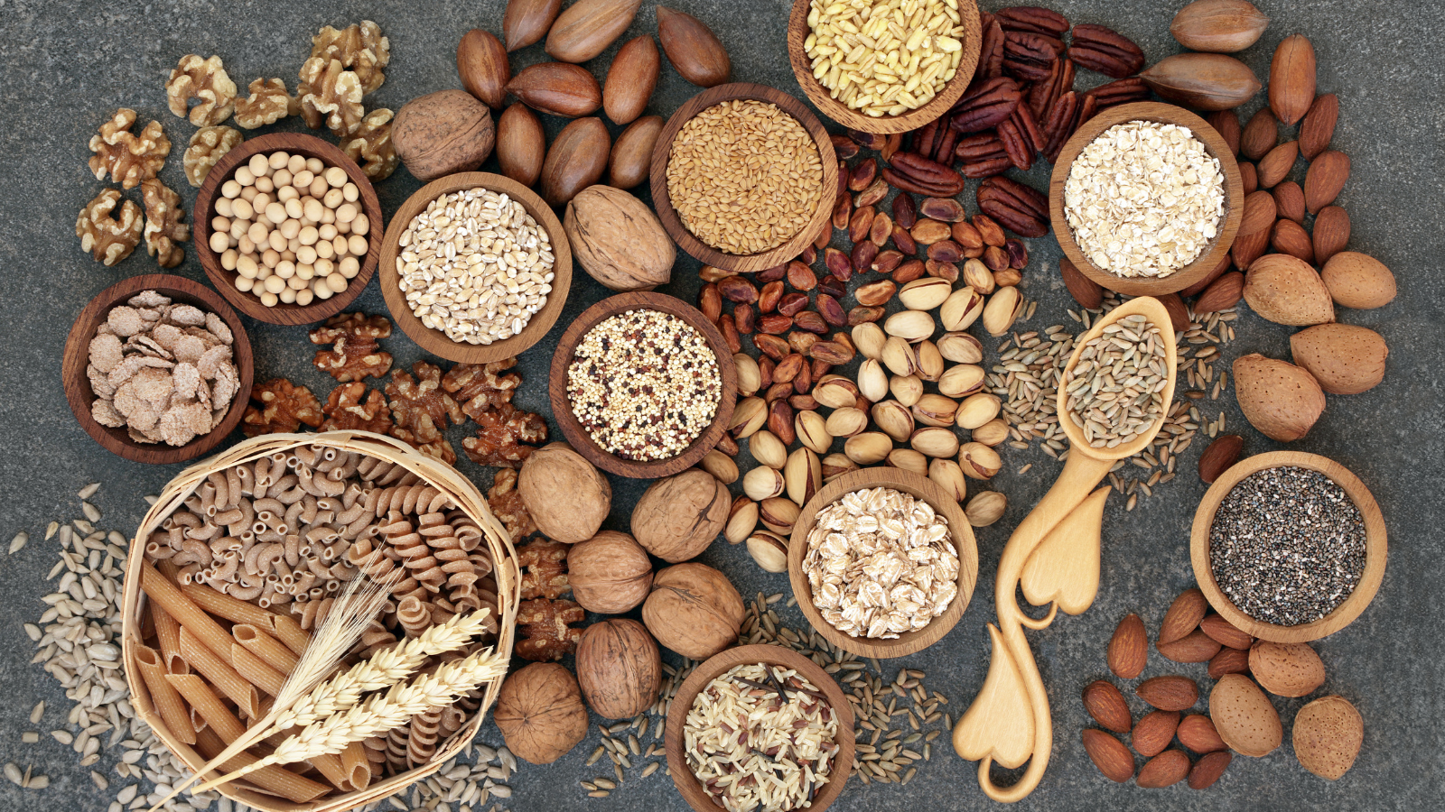 Food with high fiber content for a healthy plant-based diet with whole wheat bread, whole grain pasta, nuts, seeds, legumes, grains and cereals.
