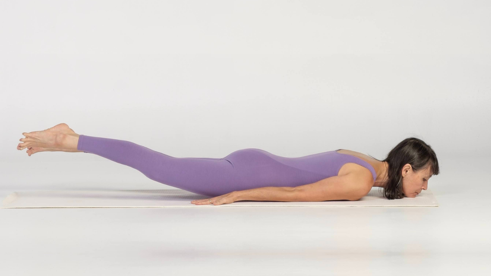 Practicing Locust Pose or Salabhasana only lifting the legs