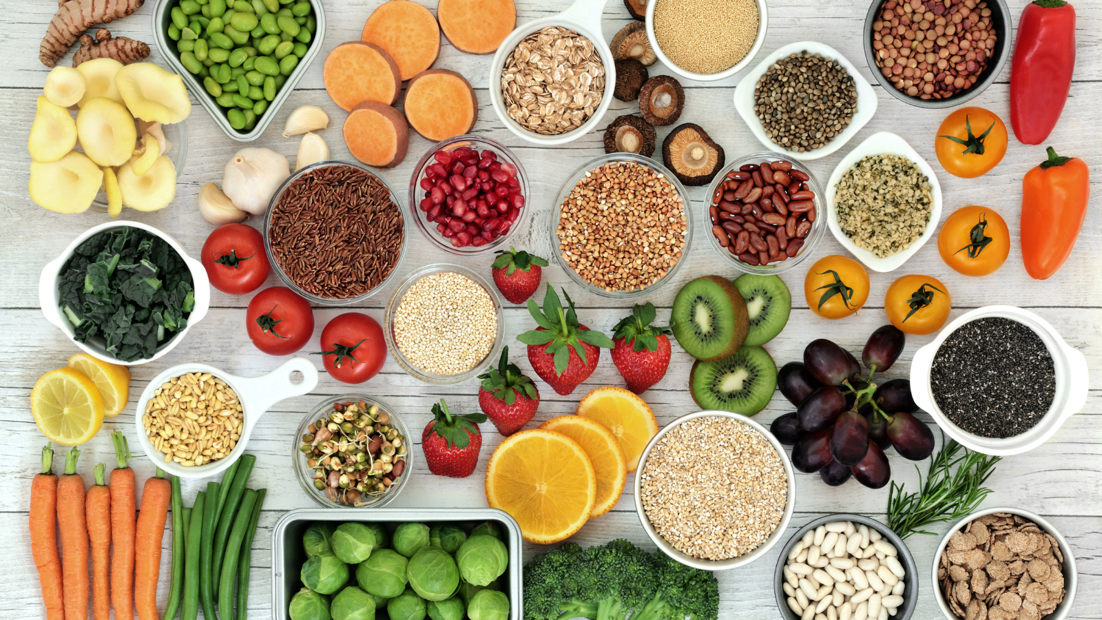 Fresh superfood concept with fruit, vegetables, grains, cereals, pulses, seeds, herbs and spices