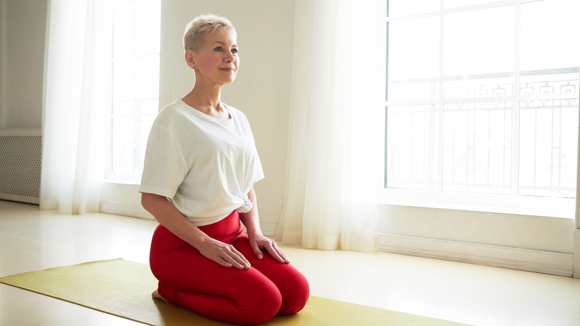 older_beginner_yoga_student_enjoying_the_benefits_of_yogic_breathing_in_yoga_class