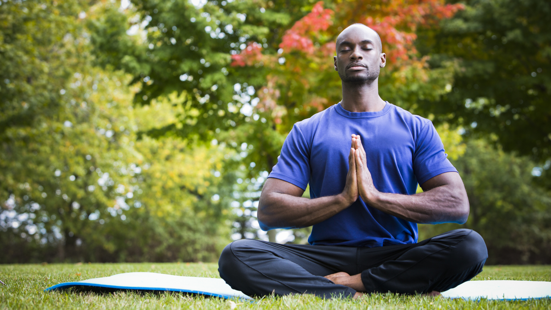 Man practicing yoga meditation with eyes closed.