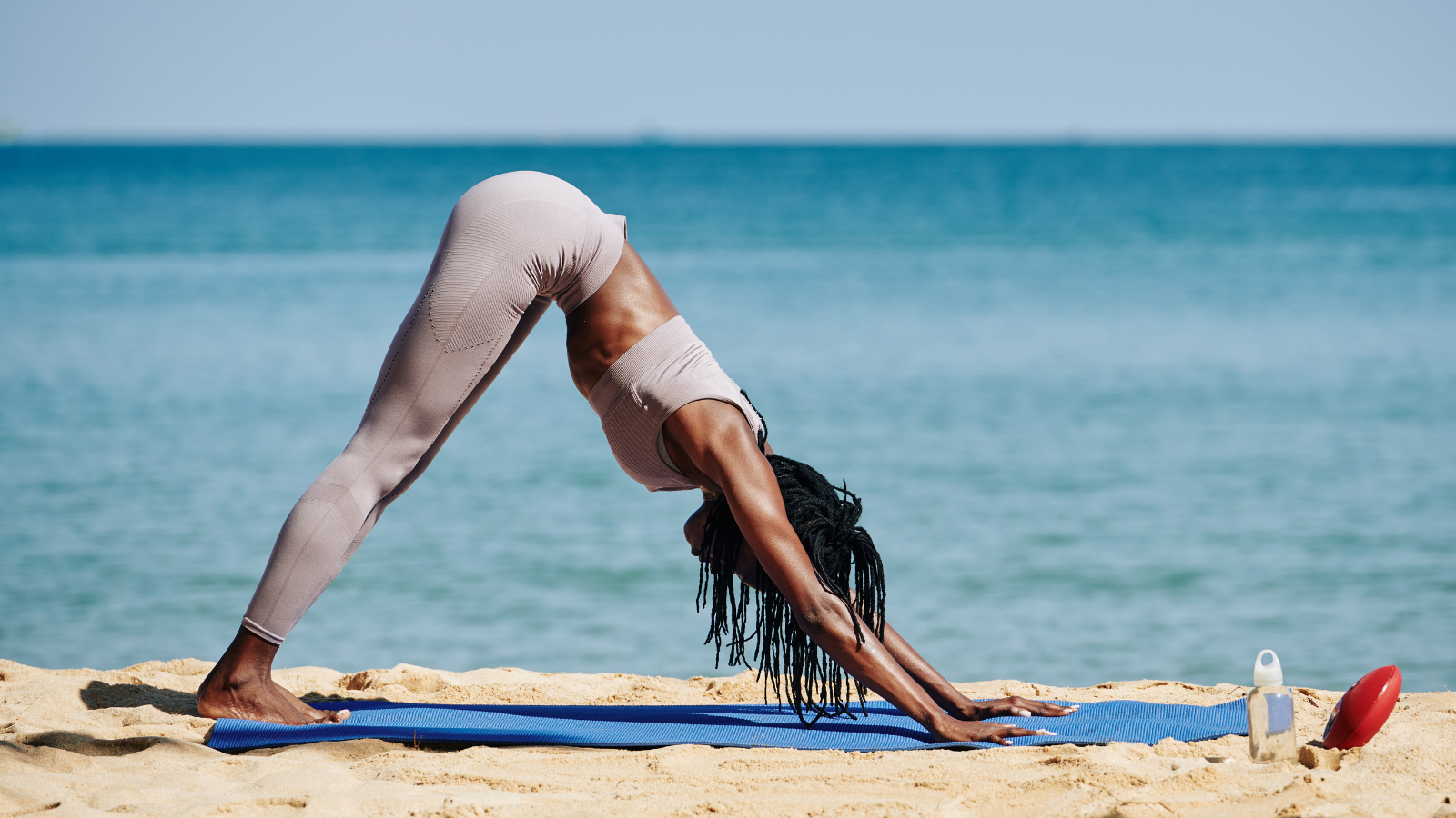 How to practice yoga to properly warm up the body and the fascia in Downward Facing Dog Pose (Sanskrit name: Adho Mukha Svanasana)