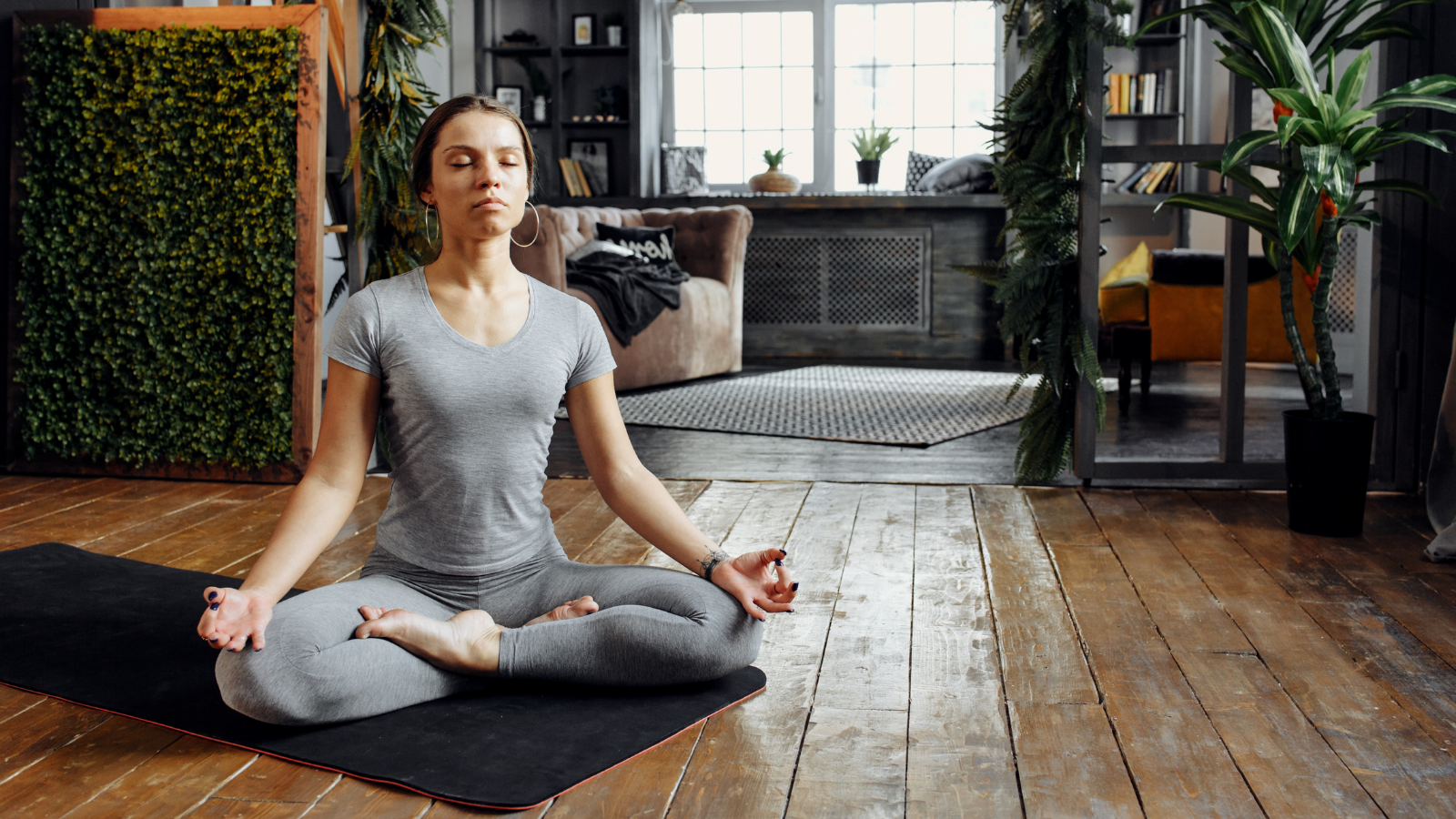 Woman practicing home yoga and meditation