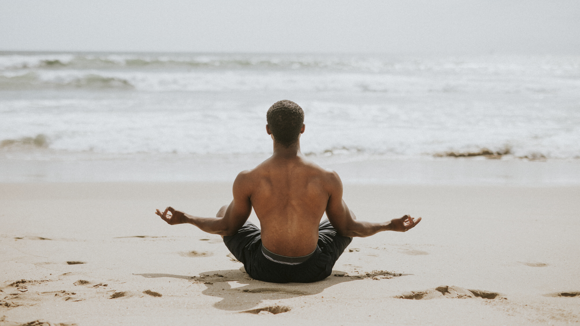 beginner_male_yoga_student_enjoying_the_benefits_of_practicing_meditation