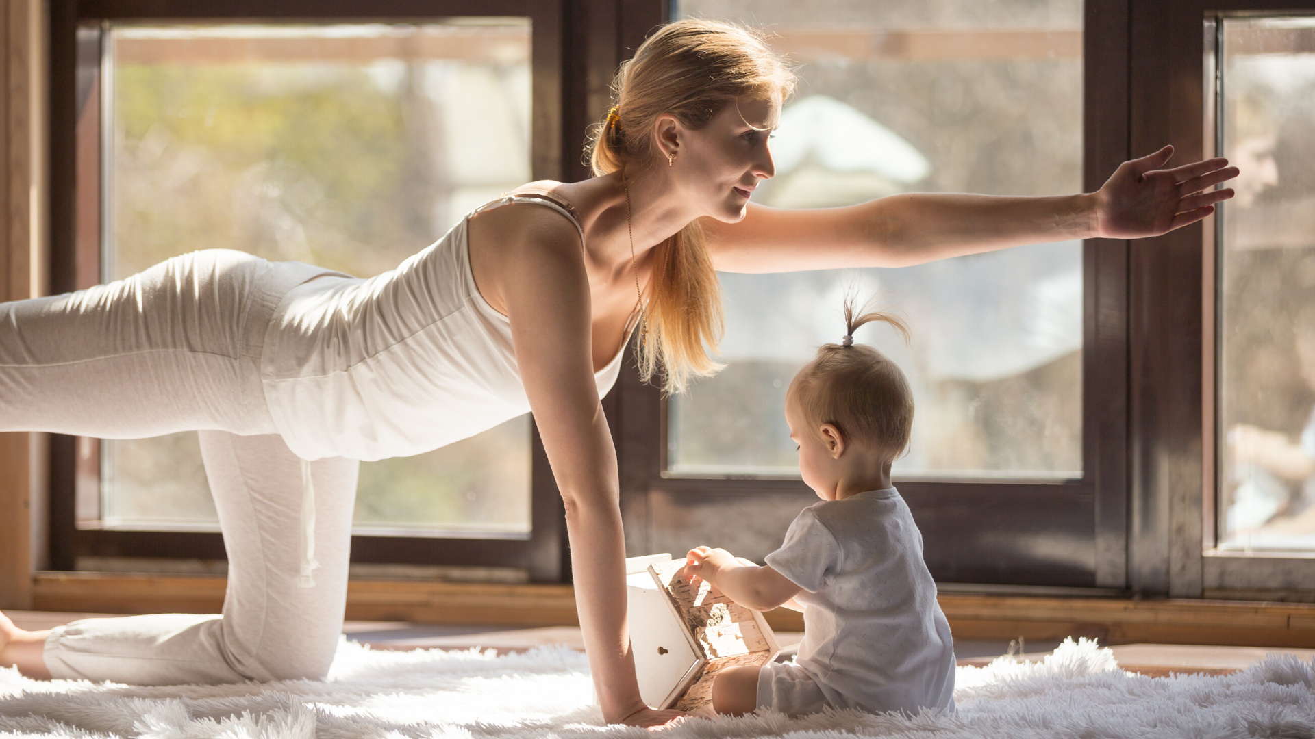 Mother practicing yoga with baby.