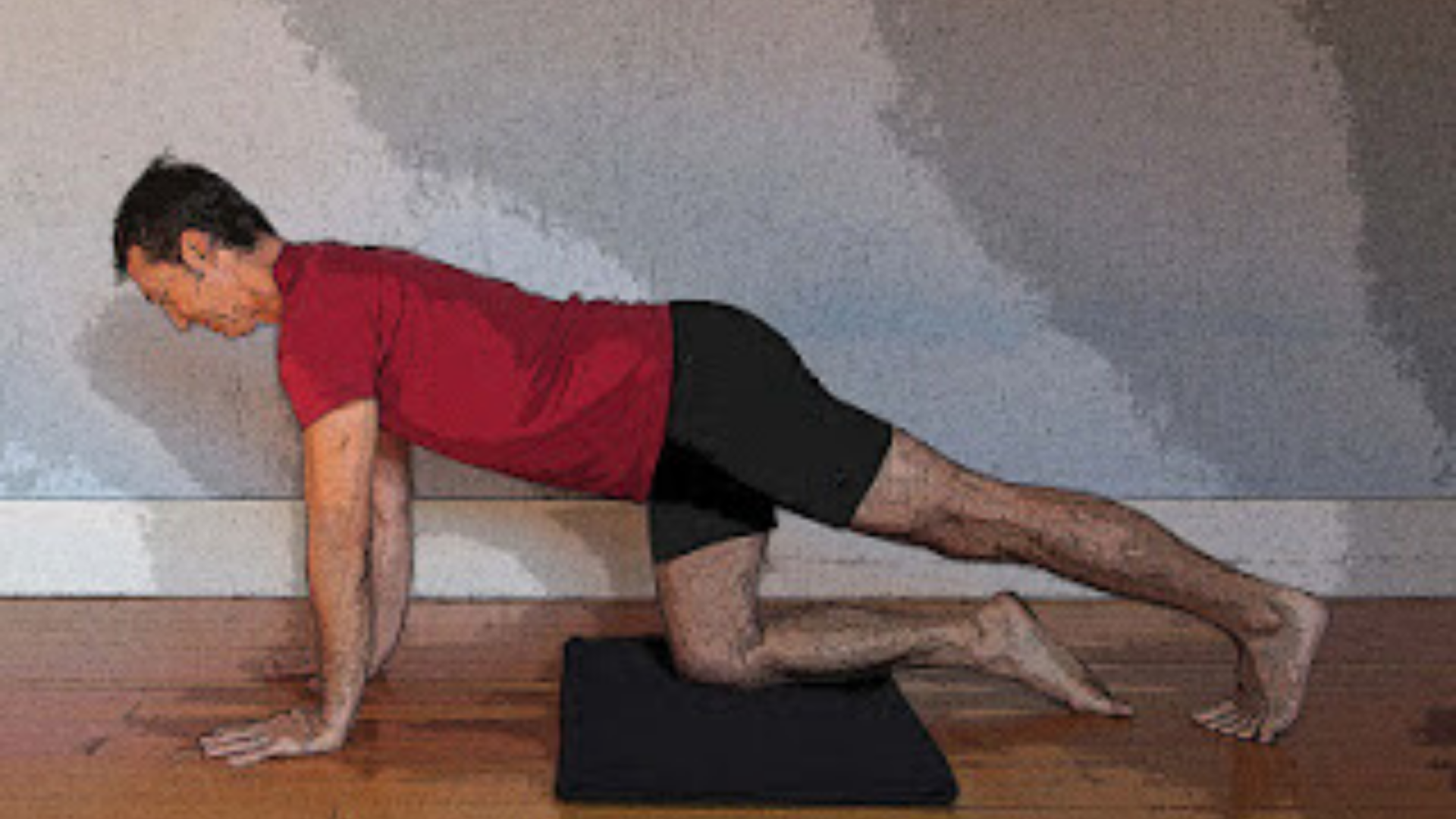 Side view of yoga teacher demonstrating how to safely exit virasana hero pose.