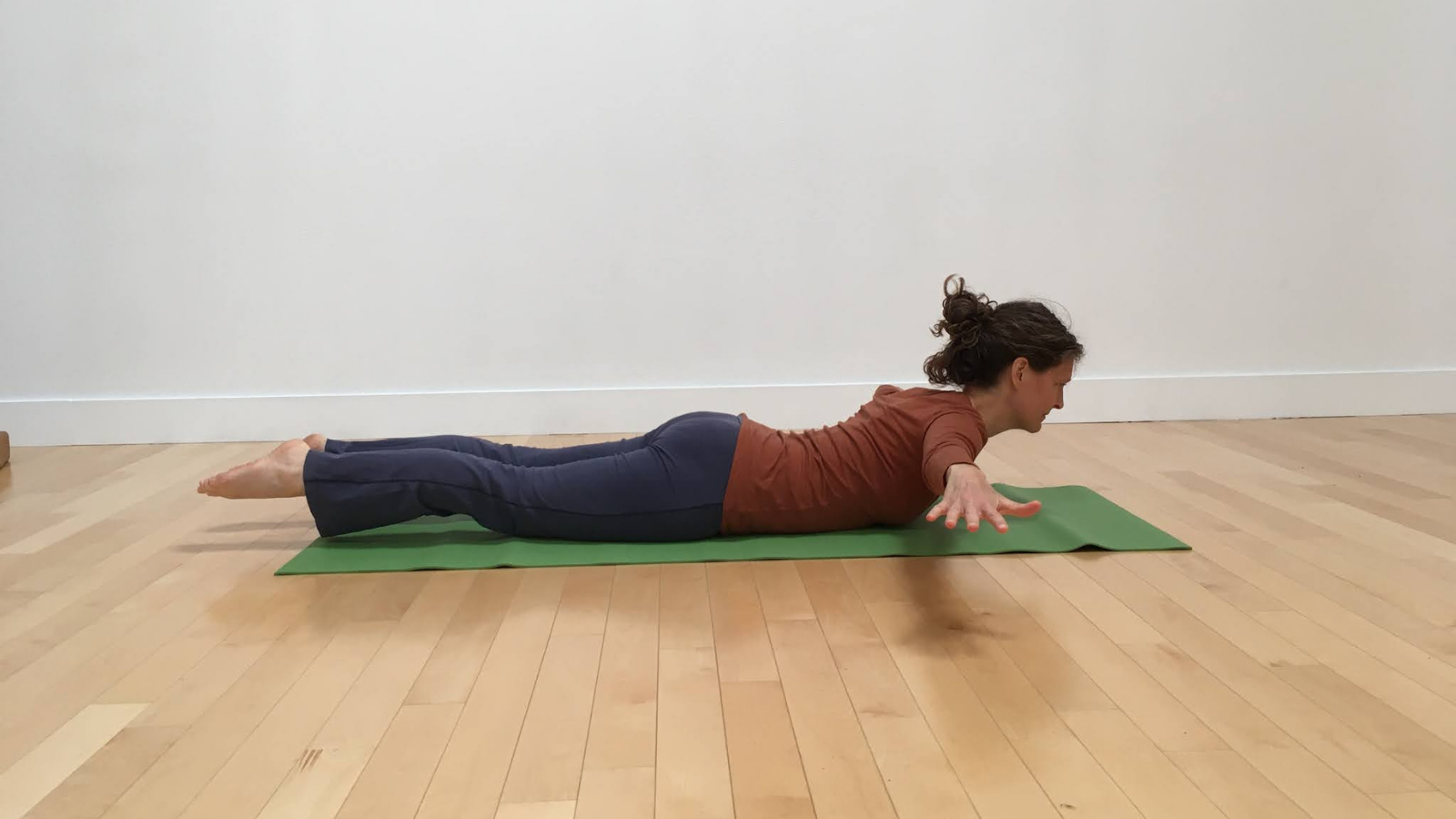 how to practice Arms-to-the-side variation of Locust pose or Salabhasana