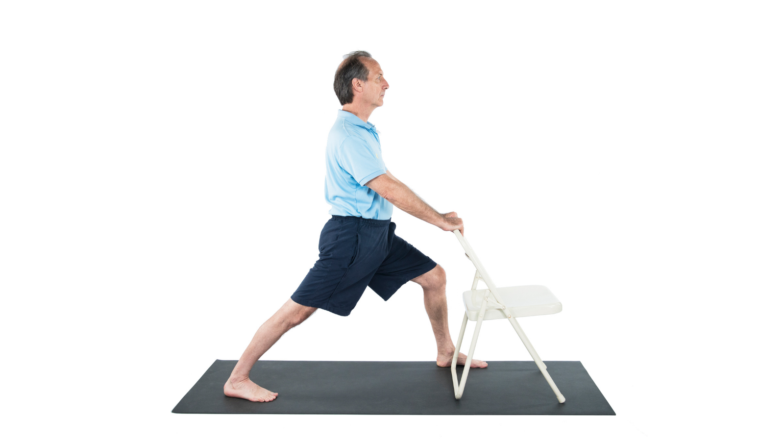Practicing Warrior I Pose or Virabhadrasana Pose with the support of a chair