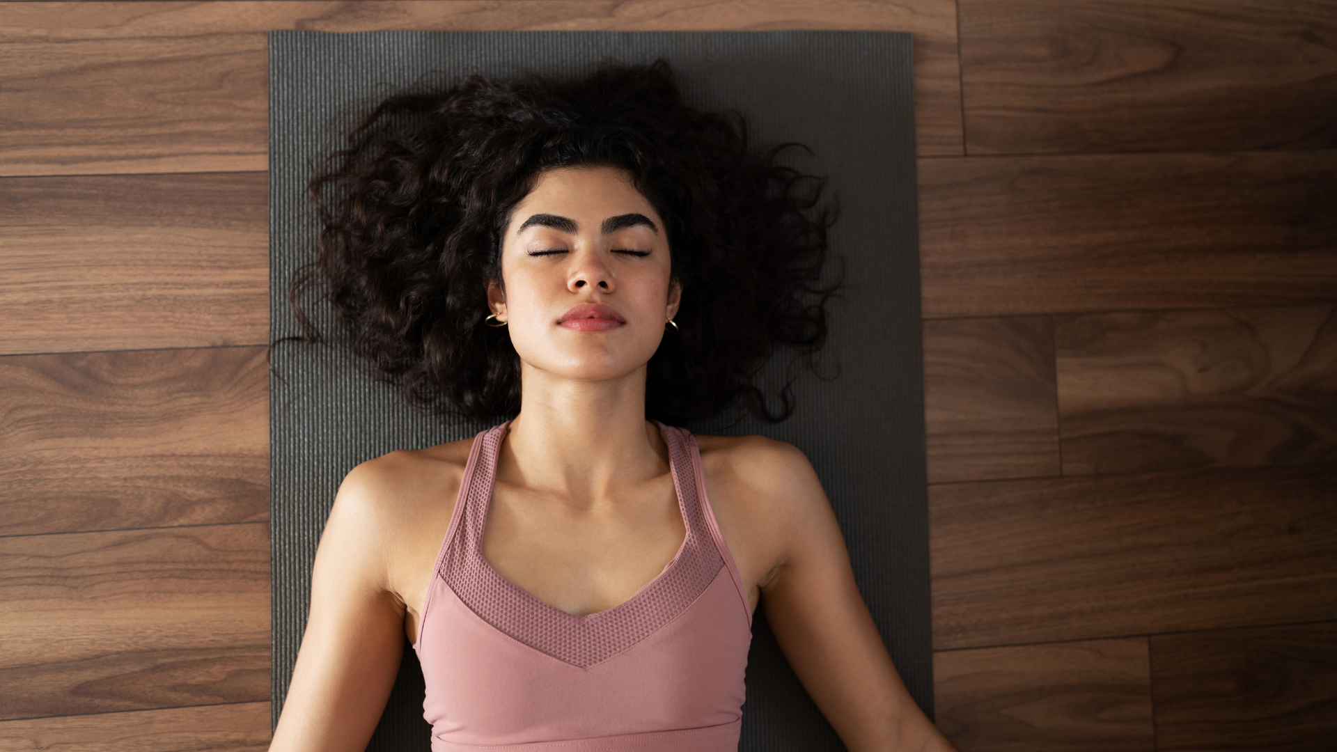 Yoga student practicing Relaxation Pose (Savasana) to reconnect with the self and find inner peace