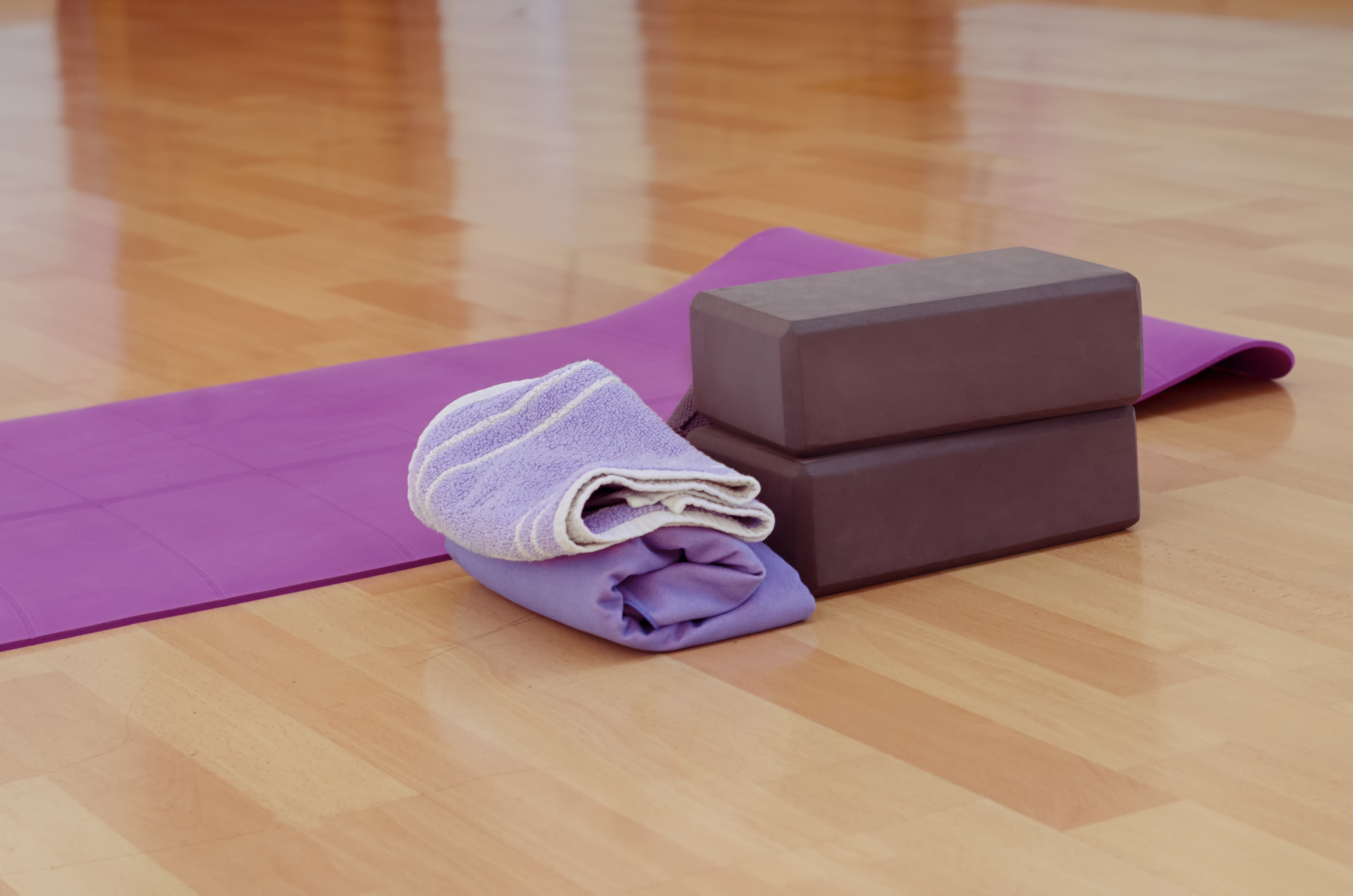 Yoga block and towel, props for yoga therapy, yoga for posture improvement, yoga to break away from your computer,