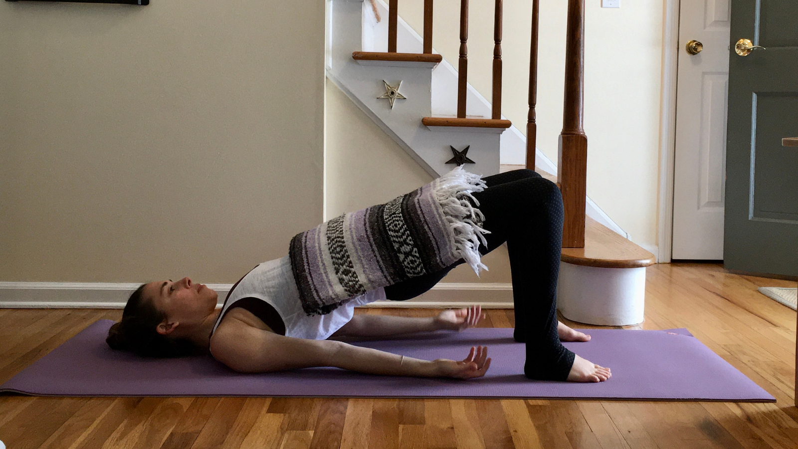 benefits of practicing weighted yoga pose in Bridge Pose to increase strength