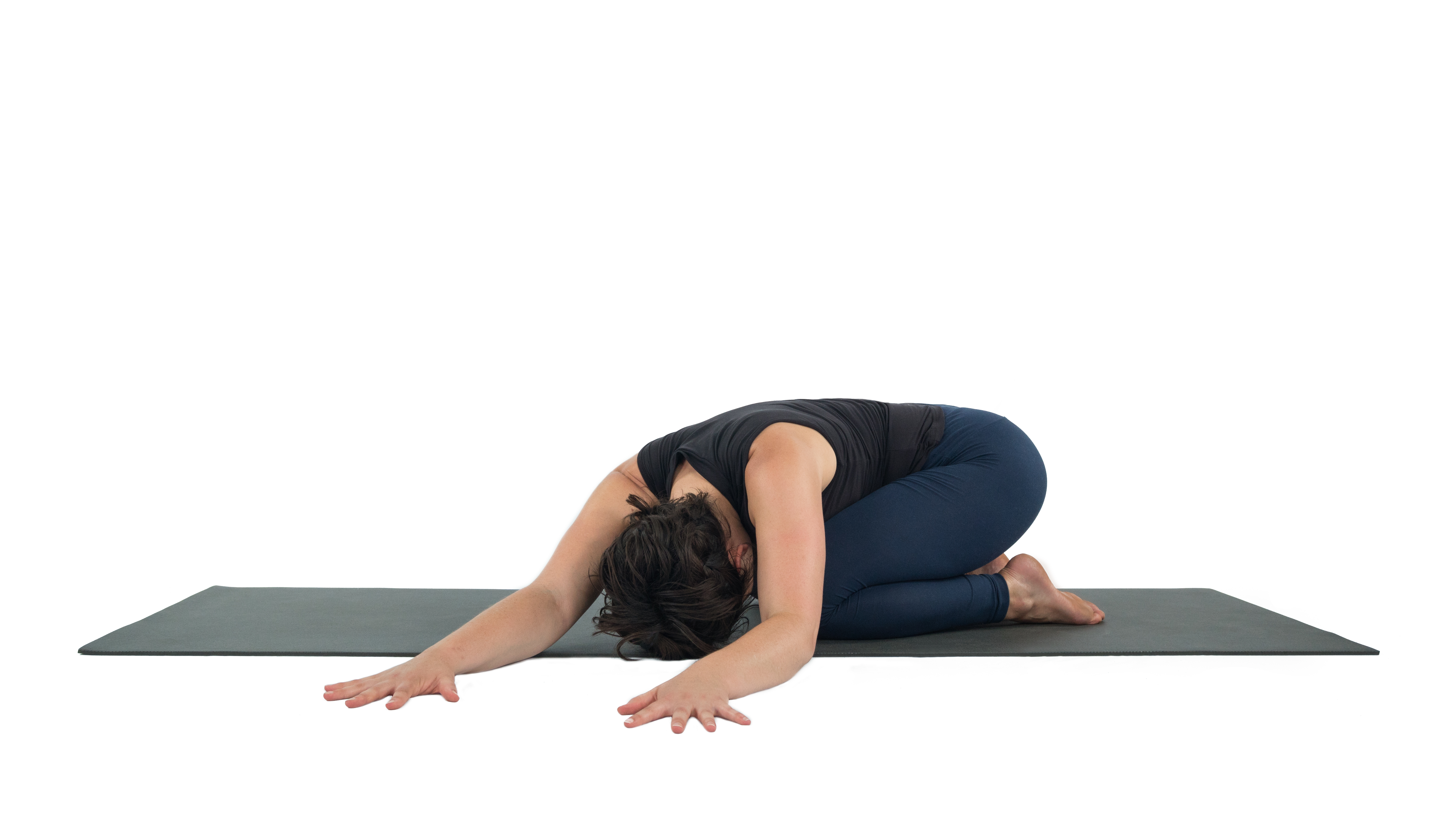 Woman practicing a variation of Child's Pose, with side stretch
