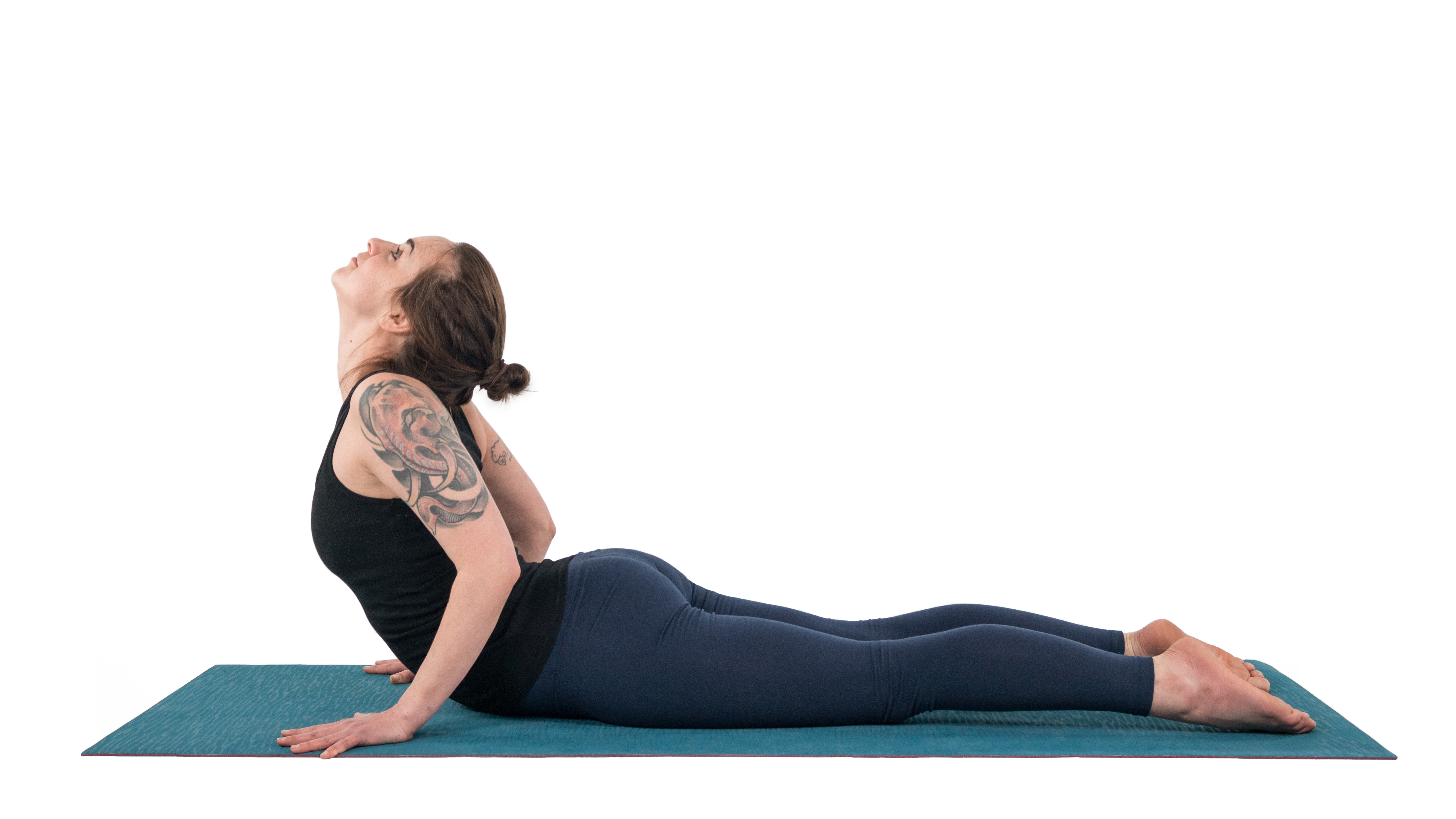 Woman practicing Cobra Pose (Bhujangasana) overarching her neck, which can be bad for the neck and shoulders