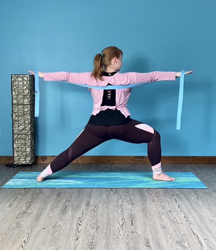 Virabhadrasana 2, warrior 2, standing pose, strengthening pose, beginner's yoga, using a strap as prop in standing poses