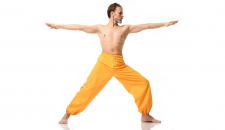 Male yoga student practicing warrior II