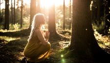 yoga woman practicing forest bathing