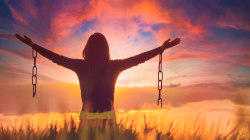 Woman holdng a broken chain representing the celebration of letting go of resentment
