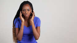 Black woman with TMJ jaw and tooth pain