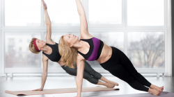 Woman practicing yoga in Side Plank Pose (Vasisthasana)