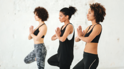 Yoga class to cope with anxiety in Tree Pose (Vrksasana)