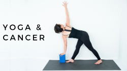 woman practicing yoga, revolved triangle pose with block