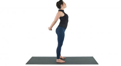 Yoga student experiencing the benefits of Shoulderstand Prep Pose to loosen tight shoulders